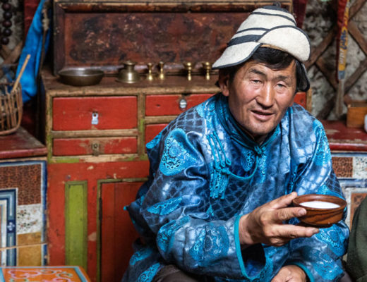 A Mongolian man holds airag, a traditional liquor, in Mongolia.