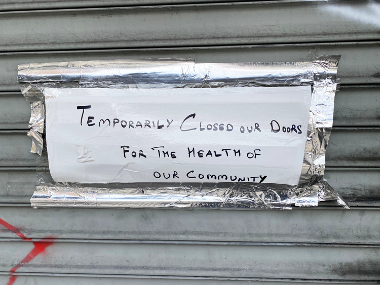 A sign announces a NYC restaurant is closed due to health concerns around coronavirus.