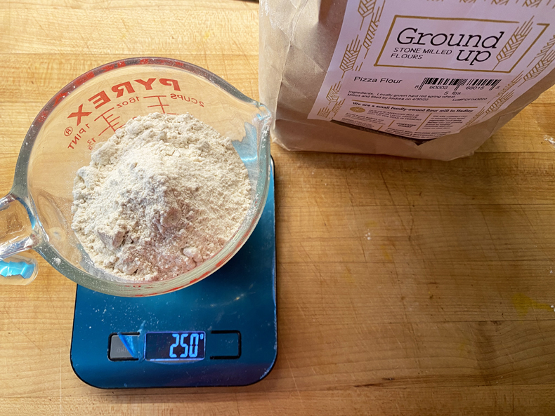 A home kitchen food scale measuring flour