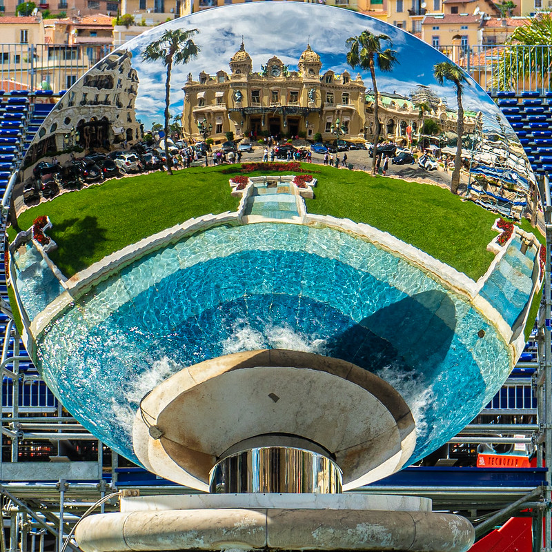View of the Monte-Carlo Casino and pool through a mirror
