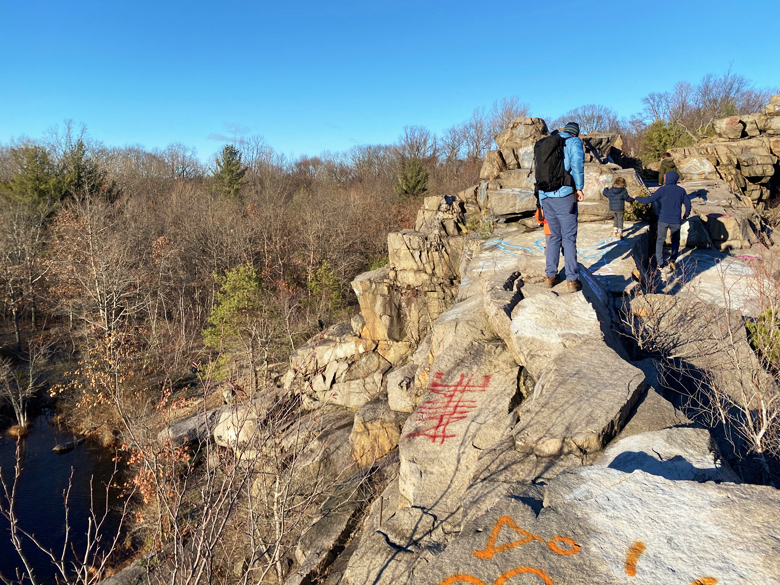Winter hikers along an old rock quarry at Cranberry Lake Preserve in White Plains, NY