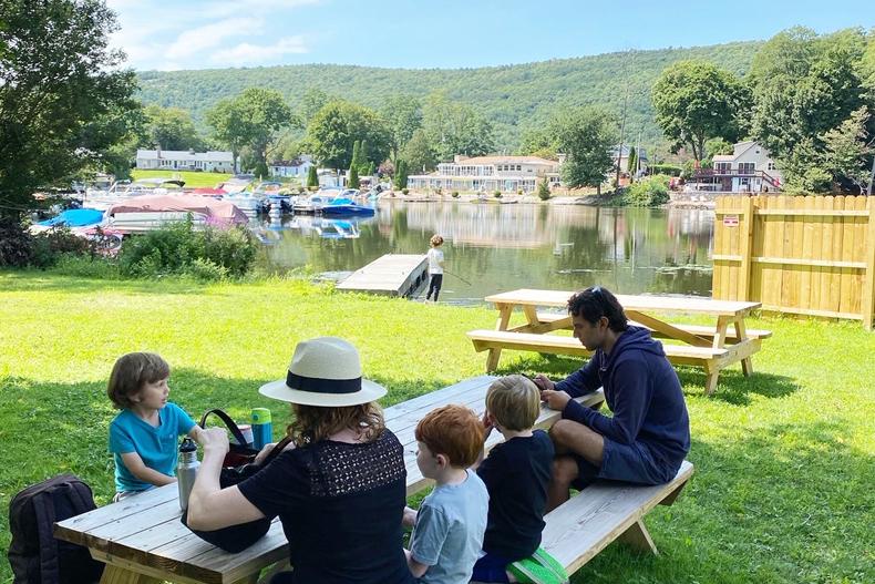 Family at a picnic table near Greenwood Lake