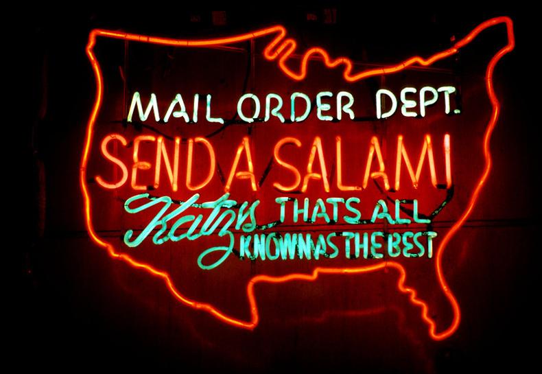 "Neon sign at Katz's Deli saying to ""send a salami"" via mail order"