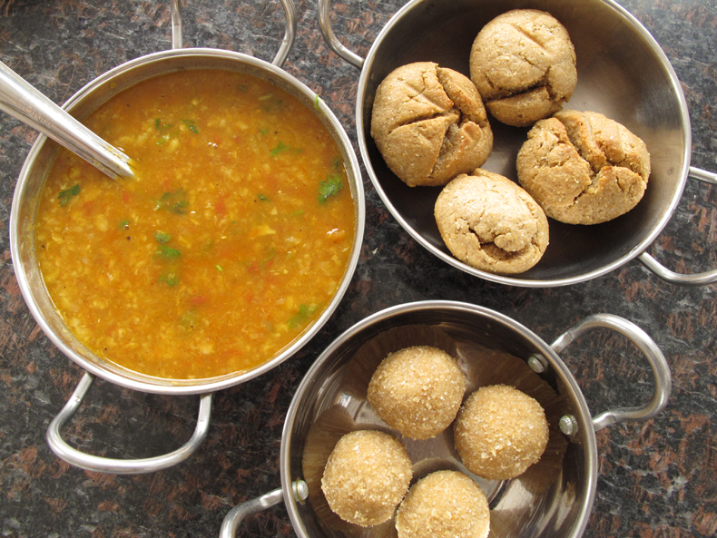 Bowls of dal, baati (a regional Indian bread), and churma from Udaipur, Rajasthan, India