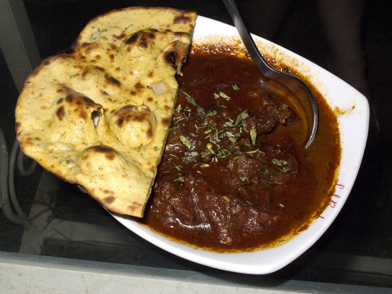 Missi roti (pictured with lal maas curry in Udaipur, India) is a regional Indian bread