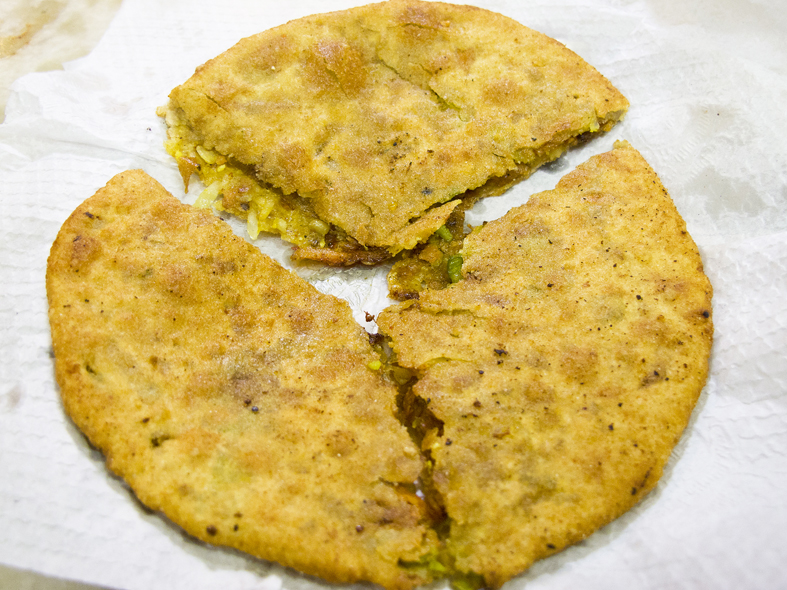 A paratha cut into thirds from Old Delhi, India