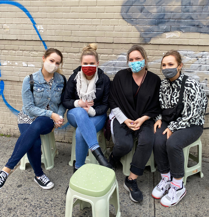 Women wearing face masks on a pandemic-safe food tour of Jackson Heights, Queens, NYC