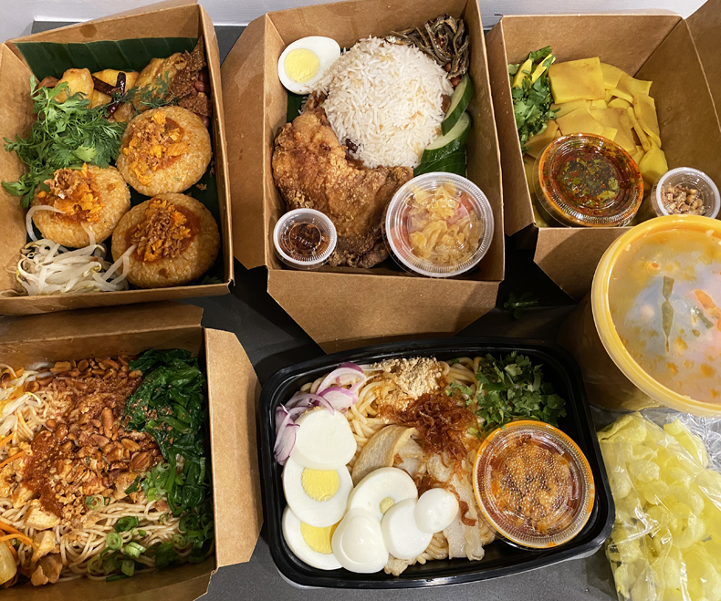 Delivery boxes filled with homemade Burmese food from De Rangoon, a home-based kitchen in Queens