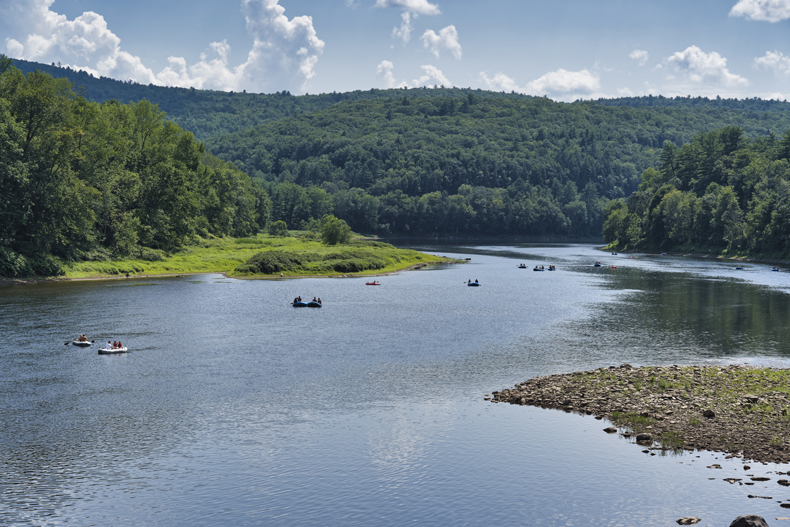 People kayaking and canoeing on the Delaware River in the Sullivan Catskills in summer