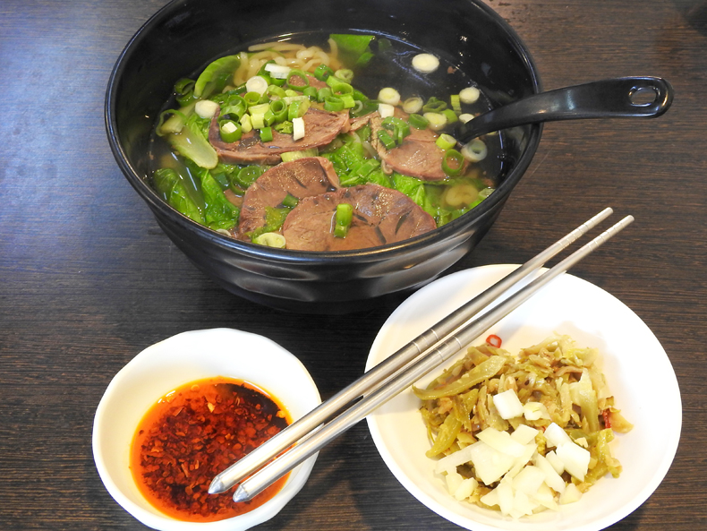 A meal of red-braised beef noodle soup with chili in Taiwan
