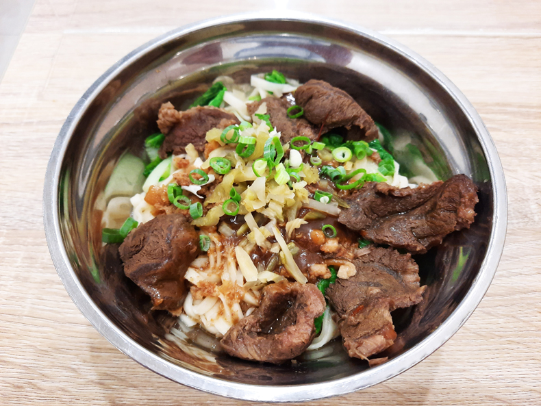 A bowl of Taiwanese beef noodles in sesame paste in Taipei