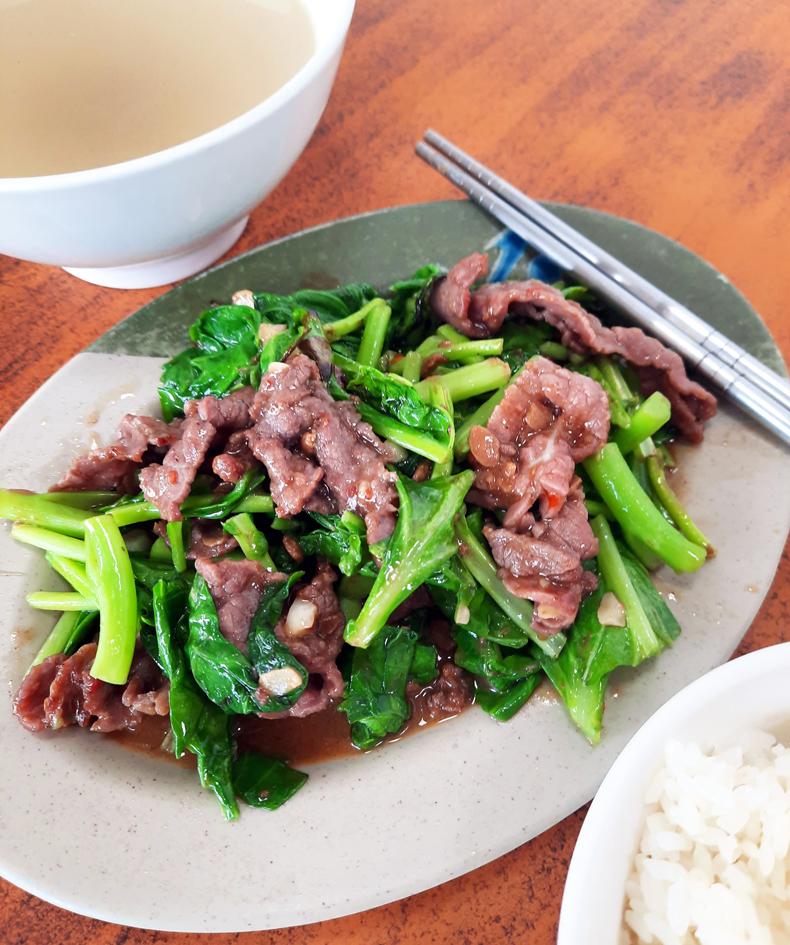 A dish of Taiwanese beef stir-fried with seasonal greens in Taiwan