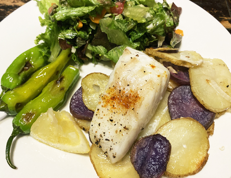 Roasted cod from Good Chop meat and seafood delivery service, served over potatoes with salad and shishito peppers.