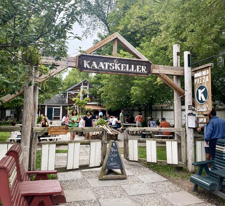 Exterior shot of the inviting Kaatskeller restaurant and garden in Livingston Manor, NY