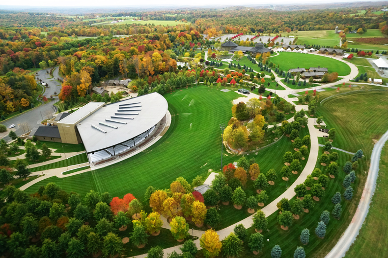Aerial view of Bethel Woods Center for the Arts in the autumn, with colorful trees all around, in the Sullivan Catskils of NY