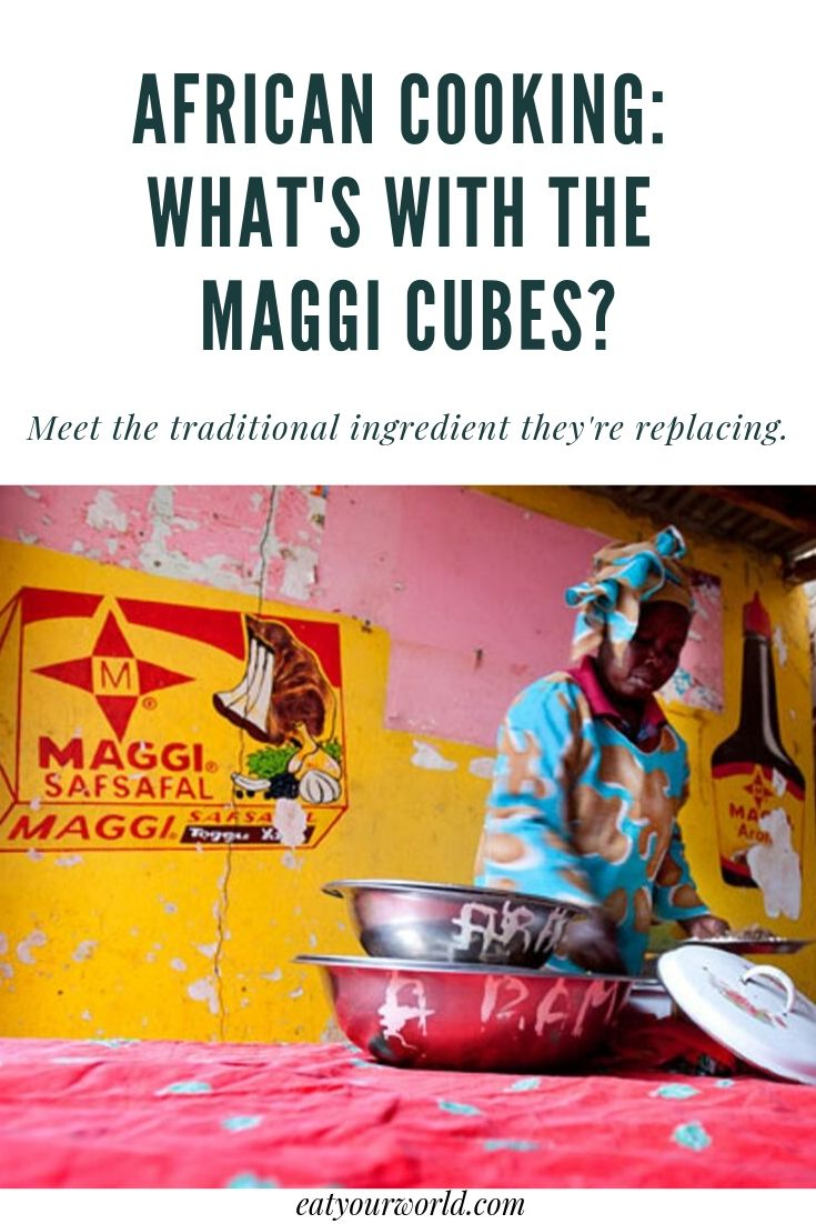 West African cooking uses a lot of Maggi cubes, but what's the traditional ingredient that's replacing? A woman is pictured cooking in Senegal.