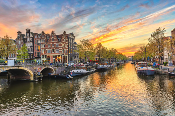 Amsterdam canal by sunset
