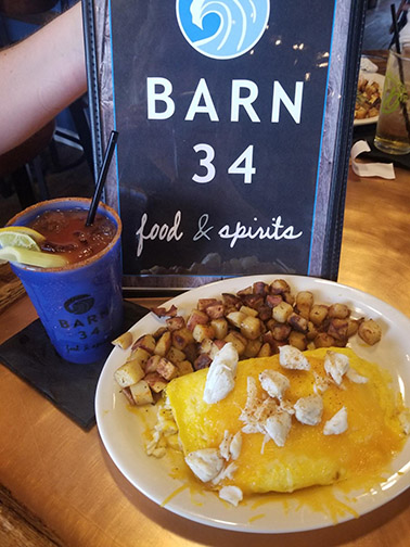 Brunch dishes (crab omelet) and bloody Mary at Barn 34 in Ocean City, Maryland