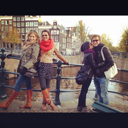 Friends posing on bridge in Amsterdam