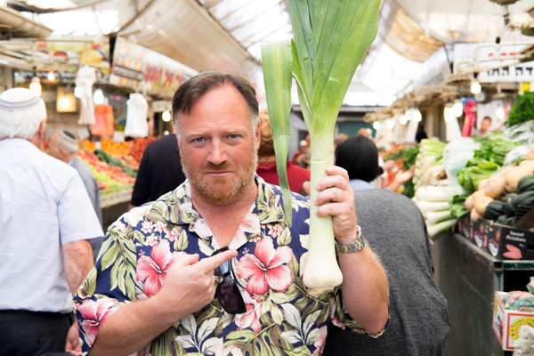 Joel Haber, a culinary tour guide in Jerusalem, at a food market