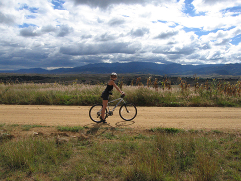 Woman bikes near Monte Alban, Oaxaca, Mexico