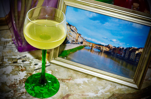 Glass of limoncello with recipe and photo of Florence.