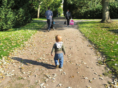 Toddler walking through Kungsparken (King's Park) in Malmo, Sweden