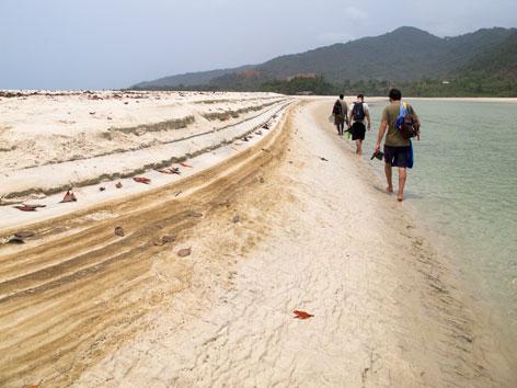 Travelers hiking River No. 2, Freetown Peninsula, Sierra Leone
