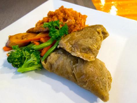 Saltfish and ducana, sweet potato dumplings, as found in an Antiguan restaurant