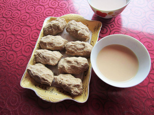 Plate of Tibetan tsampa, little barley-flour dumplings, and tea