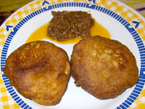 Sierra Leone-style banana pancakes with pepper sauce, from Tiwai Island, Sierra Leone