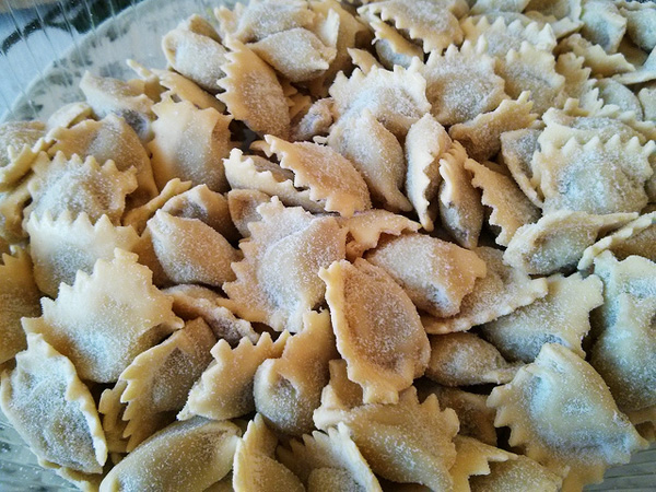Agnolotti del plin, a stuffed pasta dish common at Christmas in Piemonte, Italy