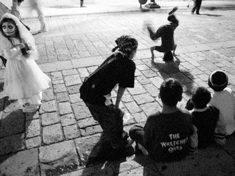 Children breakdancing in the street in Oaxaca
