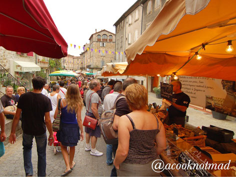 A crowded market scene from Les Vans, France
