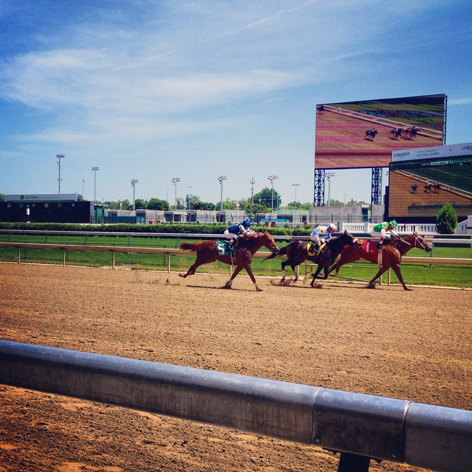 Horses racing at Churchill Downs in Louisville, KY