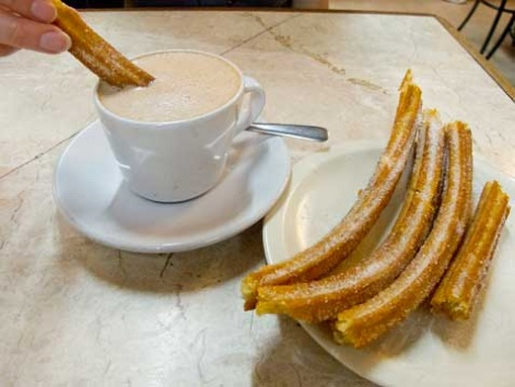 Churros dipped in hot chocolate.