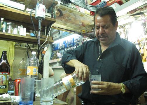 Man drinking mezcal in Oaxaca
