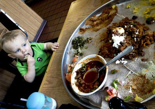 Baby eating Ethiopian food in Washington, D.C.