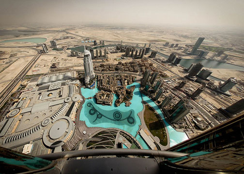 A fisheye view of Dubai from the Burj Khalifa, reflecting a cosmopolitan city rising from the brown desert