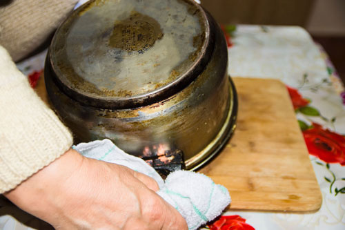Flipping the pot upside-down while making mamaliga, Romanian polenta.
