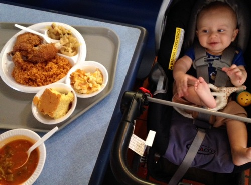 Baby looks at fried chicken in Charleston