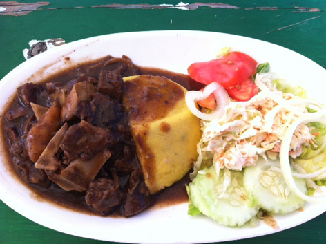 Goat water and fungee, a traditional dish in Antigua, the Caribbean