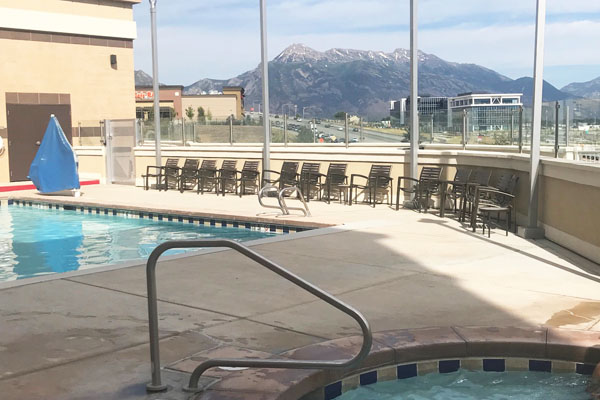 The rooftop pool and hot tub with mountain views at the Hyatt Place Lehi in Utah.