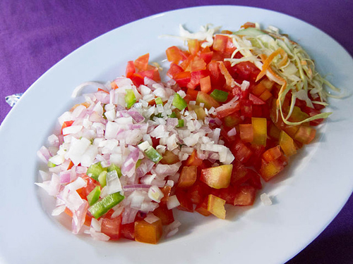 A colorful plate of kachumbari, a traditional Kenyan salsa-like dish or tomato, onion, and chili.