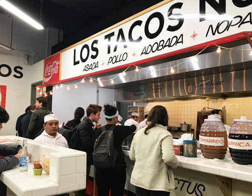 Interior shot of white counters and kitchen at Los Tacos No. 1 in Times Square