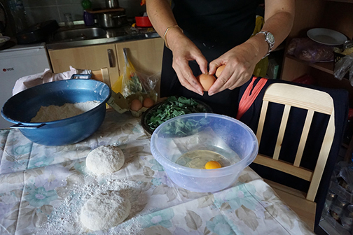 Preparing the cheese and greens filling for Bosnia burek, or pita
