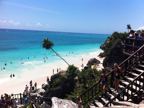 Swimmers at Tulum's Mayan ruins, Mexico