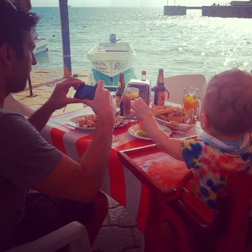 Taking photos of ceviche with a baby on Isla Mujeres, Mexico