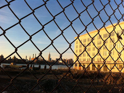 View of the NYC skyline through a fence, from Williamsburg, Brooklyn