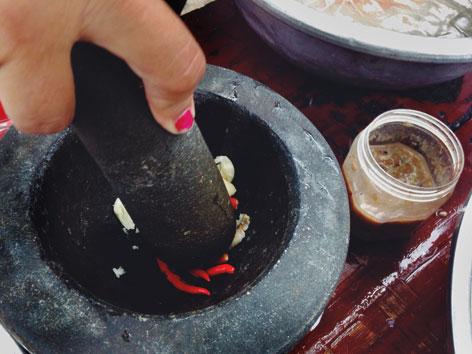 Mortar and pestle for making som tam, Thai papaya salad